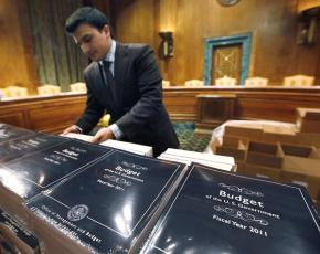 Copies of Obama's budget proposal stacked for distribution to senators