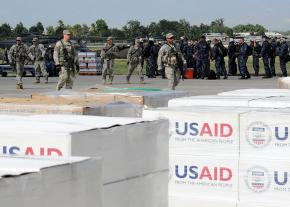 Relief aid piled up at the airport in Port-au-Prince, under the control of U.S. troops