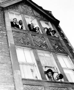 Martin Luther King Jr. and Coretta Scott King wave to supporters after moving into an apartment on Chicago's West Side in 1966.