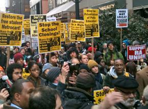 Protesters line up for a huge march against budget cuts in New York City