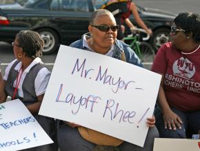 Teachers and their supporters rallied against Michelle Rhee's announcement of hundreds of layoffs