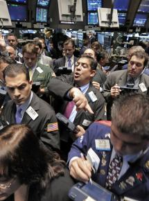 Wall Street traders on the floor of the New York Stock Exchange