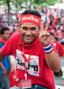 A Red Shirt protester in the streets of Bangkok during the mass marches in April