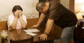 An unemployed couple struggles to keep up with bills