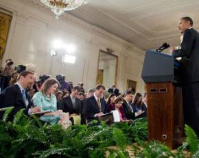 Members of the press listen attentively to President Obama during a White House press conference