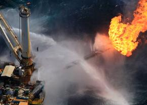 A giant flame roars off the side of a rig at the site of the Deepwater Horizon well