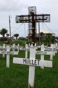 A makeshift cemetary set up in Grand Isle captures the toll of the BP oil disaster on the Gulf Coast