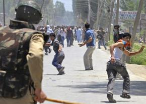 Indian security forces rush a crowd during efforts to contain protests in Kashmir