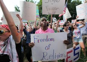Some 500 people gathered for a hastily organized counter-protest against the attack on Muslims