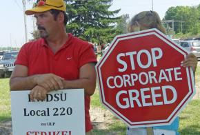 Strikers on the picket line at the Mott's plant in Williamson, N.Y.