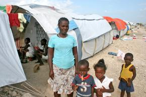A family living in the Corail Cesselesse camp outside Port-au-Prince in July