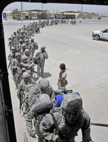 A battalion of U.S. soldiers boards a plane leaving Baghdad