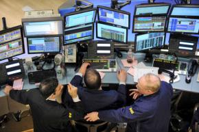 Traders watch the ups and downs of the futures markets