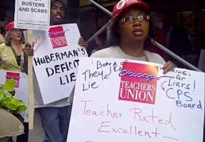 Members of the Chicago Teachers Union rally against layoffs in July