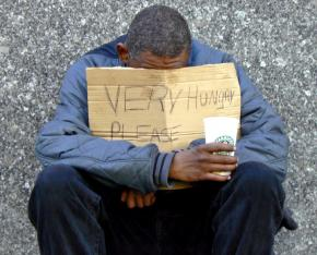 A homeless man asks for help on Chicago's Michigan Avenue