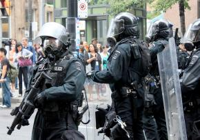 Riot police face down protesters outside the G20 Summit in Toronto
