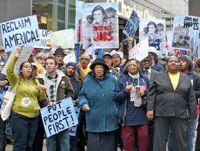 Protesters march for a just economy that puts jobs, homes and people before profits