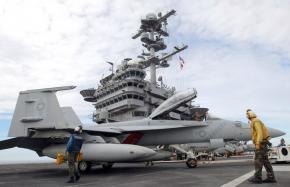Pilots conduct test flights from the deck of the USS George Washington aircraft carrier off the coast of the Korean Peninsula