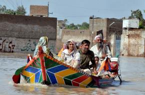 A family escaping floods in Northwest Pakistan in July