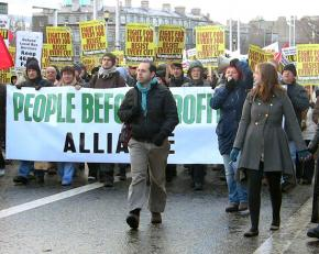 """Tens of thousands march in Dublin against proposed cuts as a consequence of the EU-IMF """"rescue"""" plan"""