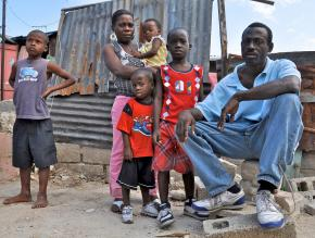 One of hundreds of thousands of homeless families still living amid the rubble in Port-au-Prince