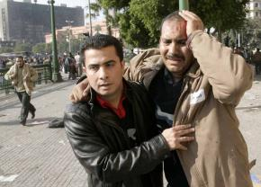A protester wounded by pro-Mubarak thugs who charged the crowds in Tahrir Square