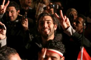 Protesters celebrate their victory as Mubarak is forced to step down