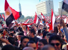 Egyptians celebrate the downfall of dictator Hosni Mubarak