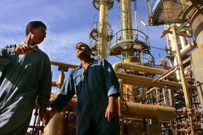 Iraqi oilworkers at a refinery outside Baghdad