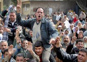 Workers at a factory in Suez strike following the successful revolt against Mubarak