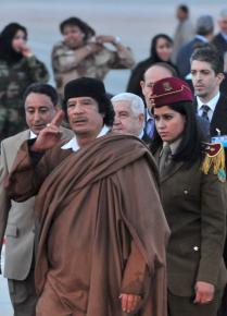 Col. Muammar el-Qaddafi walks with his bodyguards