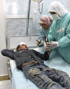 A 14-year-old boy injured by Qaddafi's forces outside of Brega