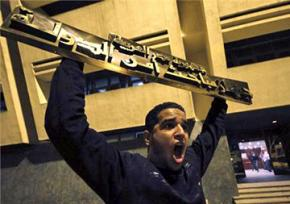 Protesters breaking into the Egyptian State Security building