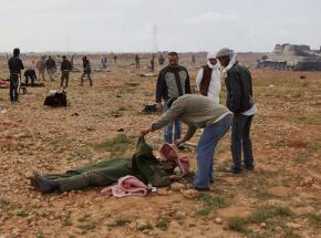 Libyans survey the damage and casualties from U.S.-led bombing