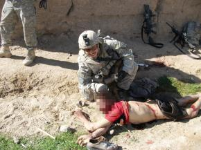 A U.S. soldier posing with an Afghan civilian murdered by members of his unit