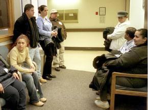 Patients wait for care at a public hospital