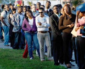 Job seekers wait in an endless line for a chance at work