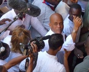 Haitian Presdent Michel Martelly surrounded by the media