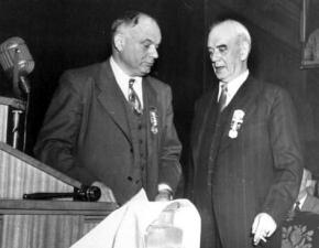 Philip Murray (right) preparing to address the 1948 CIO convention