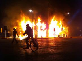 A store blazing on Tottenham High Road on the first night of rioting in London