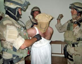 U.S. Navy Seals surround an Iraqi detainee