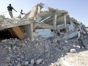 Kids search through the rubble of a school in Cité Soleil following the earthquake