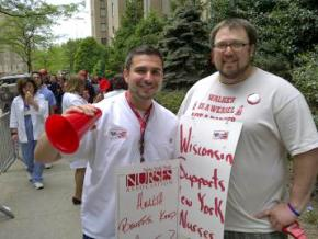 Anthony Ciampa (left), a newly elected director at large of the NYSNA, stands with a supporter at a protest