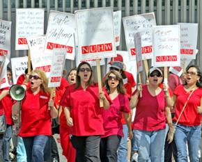 Health care workers march outside the Kaiser Permanente Los Angeles Medical Center