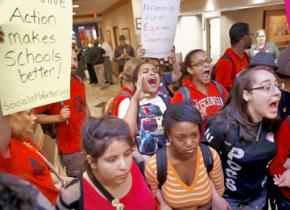 Students standing up for affirmative action make their way into a press conference