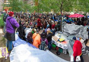Hundreds of people poured into Liberty Plaza to defend it against a threatened eviction
