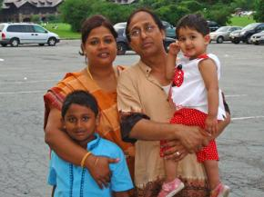 Ahmed Hossain with his wife and children