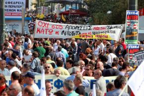 Greek workers march in Athens during the one-day strike on October 5