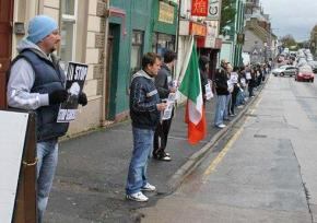 Protesters line the streets of Lurgan in defense of Irish republican political prisoners