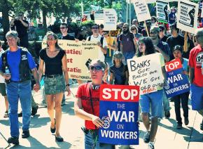 Protesters march in support of labor at Occupy Austin